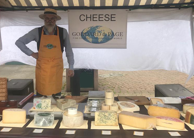 An image of a chees stall on a market.